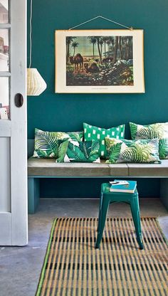 Easy and cheap way to get old colonial decor feel, and add colour to your home, is to add a rich wall colour, straw mat and tropical pillows.