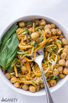 This sweet potato and zucchini noodles with pesto and chickpeas recipe is made as a savory vegetarian dish, perfect for a healthy make-ahead lunch or dinner. | slimsanity.com