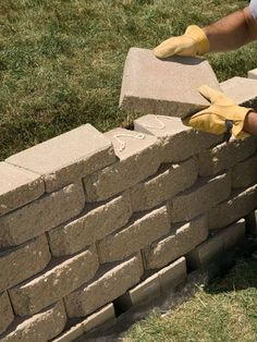 Building an interlocking retaining wall in yard | Tiered landscape brick wall idea | Put on caps | tash bkyd
