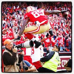 Sept.16 2012 - Detroit Lions at San Francisco 49ers - a great shot of Vernon Davis leaping over photographers in the end zone.