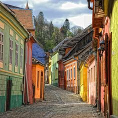 Sighisoara, Romania is a medieval fortified city in the historic region of Transylvania, listed as a UNESCO World Heritage Site. Beautiful Streets, Beautiful Places, Amazing Places, The Places Youll Go, Places To See, Beau Site, Famous Castles, Belle Villa, Albania