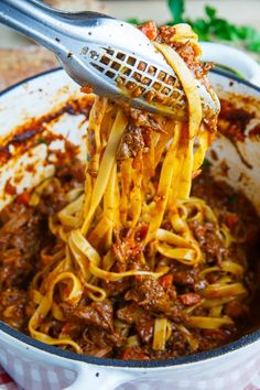 Short-rib Bolognese Tagliatelle Short-rib Bolognese ~ A slowly braised beef short rib bolognese that is absolutely packed with flavour!Tagliatelle Short-rib Bolognese ~ A slowly braised beef short rib bolognese that is absolutely packed with flavour! Slow Cooker Recipes, Beef Recipes, Cooking Recipes, Slow Cooking, Recipies, Cooking Rice, Beef Dishes, Pasta Dishes, Italian Dishes