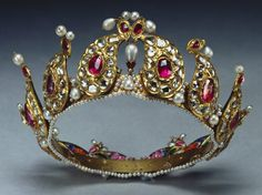 Presented to Queen Victoria & placed among Indian Collection belonging to Crown by King George V in 1924.  Description:   A ruby, diamond and pearl tiara formed from twelve gold, tear-shaped sections mounted with diamonds and rubies, on a gold and pearl band, with enamel portraits at back.