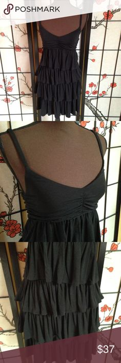 J. Crew Tiered Ruffle Mini Dress, Black, Small Great condition black tiered ruffle dress from J. Crew. The chest has slight ruching and spaghetti straps (nonadjustable). This stretchy dress is made of 95% rayon and 5% spandex. Excellent quality! Retails new at $69.50. J. Crew Dresses Mini