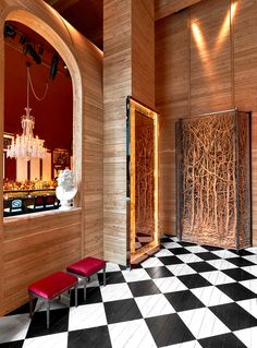 The Baccarat Hotel in New York City. Checkered floors & Baccarat chandeliers...