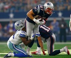 New England Patriots vs. Dallas Cowboys - Photos - October 11, 2015 - ESPN   -    ARLINGTON, TX - OCTOBER 11: Rob Gronkowski #87 of the New England Patriots tries to break away from Byron Jones #31 of the Dallas Cowboys during the second half of the NFL game against the New England Patriots at AT&T Stadium on October 11, 2015 in Arlington, Texas. (Photo by Mike Stone/Getty Images)