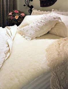 SnugFleece Original Wool Mattress Pad - Queen SnugFleece,http://www.amazon.com/dp/B000WWXQQQ/ref=cm_sw_r_pi_dp_HXuetb1S4S6C6YF8