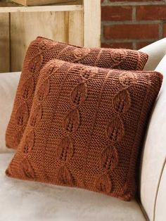 "Give your home decor a quick autumn pick-me-up with this portable project. The throw pillow features an intriguing lacy leaf stitch pattern. This e-pattern was originally published in the September 2011 issue of Creative Knitting magazine. Size : 13"" x 13 3/4"", 17"" x 17 3/4"", without pillow form. Made with medium (worsted) weight yarn, size 8 (5mm) needles and size * (5mm) crochet hook. Skill Level: Easy"