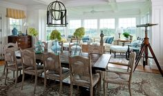 I love the easy flow of the very non-formal dining room into the sunroom...and gorgeous colors!  From House of Turquoise...I could pretty much pin every picture from that blog!