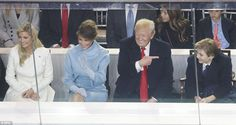Once in their seats, the First Family enthusiastically greeted the parade's many participants, smiling and waving as they passed by