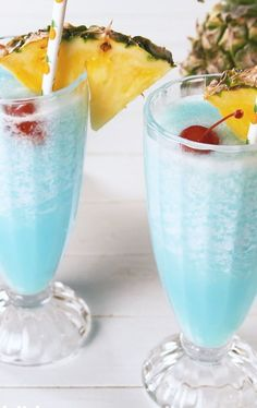 Booze up and cool down this summer with Blue Hawaiian Coolers. Get the recipe at  #recipe #easy #easyrecipes #delish #rum #blue #hawaiian #summer #cocktail #drink #boozy #cherry #pineapple #curacao Blue Drinks, Fruity Drinks, Frozen Drinks, Easy Alcoholic Drinks, Drinks Alcohol Recipes, Cocktail Recipes, Limoncello, Sangria, Exotic Food