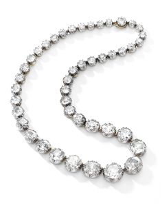 Diamond rivière, mid-19th century Composed of a graduated line of pinched collet-set cushion-shaped and circular-cut diamonds, length approximately 385mm.