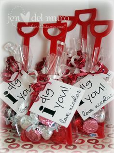 The shovels {purchased on eBay} are inside a cello bag with a handful of Valentine Hershey Kisses. Each bag is tied off with red and white curling ribbon {purchased on clearance after Christmas} and a personalized computer generated sentiment…