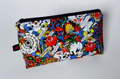 A personal favorite from my Etsy shop https://www.etsy.com/ca/listing/288307375/tattoo-print-makeup-bag-rockabilly
