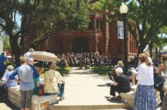 Residents gather Thursday at the historical ellis County Courthouse to hear community leaders pray about local issues during National Day of prayer.