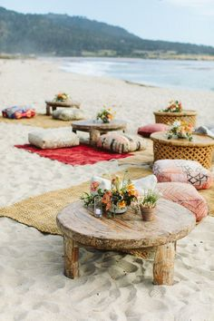 Low rustic wooden tables combined with colorful textured rugs and floor cushions create an inviting, boho inspired seating area Wedding Reception Decorations, Table Decorations, Wedding Decor, Wedding Ideas, Deco Nature, Festa Party, Beach Picnic, Beach Dinner, Welcome To The Party