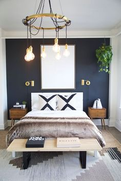 Go Inside 5 Of The Dreamiest Lofts In America modern boho bedroom decor, modern bedroom with navy wall and brass sconce, modern bedroom light, boho bedding, boho bedroom design with faux fur and nightstand decor Bedroom Colors, Home Decor Bedroom, Bedroom Ideas, Bedroom Designs, Bedroom Furniture, Bedroom Couch, Wooden Bedroom, Small Furniture, Furniture Design
