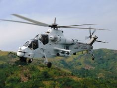 In November 2013 three South African Denel Rooivalks were deployed to the Democratic Republic of Congo as part of the United Nations operation there. Shortly after arrival they fired their weapons in anger for the first time, attacking M23 rebel positions. Since then, these white Rooivalks have successfully engaged other rebel targets in the DRC. Attack Helicopter, Military Helicopter, Military Aircraft, Army Vehicles, Armored Vehicles, Augusta Westland, C130 Hercules, South African Air Force, Defence Force