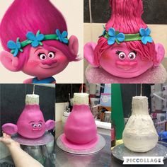 Trolls Princess Poppy Cake made By Me Elena Purton. This was my granddaughters cake and I didn't think it looked anything like her till my daughter showed me this picture of it in the process of me making it. It was a challenging one to say the least.