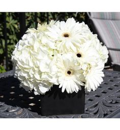 Black & White centerpiece of hydrangea and gerberas $35.00 (the daisies can be subbed for red (only a couple hydrangea in this piece to keep cost down)