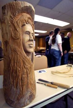 This finished bust is of  Beautiful Woman that he carved into a log.  Herman Davis, a local woodcarver and story teller, was at the Beaumont Public Library Downtown branch this week, demonstrating his art of carving all types of wood, and telling his folk stories during a program for adults. He brought with him several large examples of carving that he has finished as well as continues to carve on.   Dave Ryan/The Enterprise