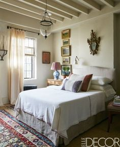 Simple bedroom idea featured in a Manhattan penthouse full of antiques from around the world.