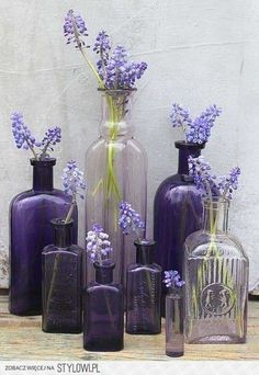 Love these antique bottles with sprigs of lavender in...