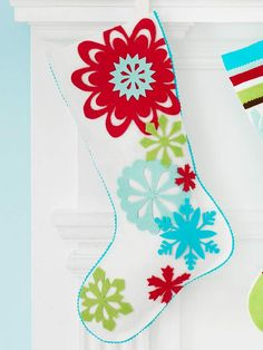 Make your own stockings to hang by the chimney with care. Get instructions for this Snowflake Felt Stocking here: http://www.bhg.com/christmas/stockings/easy-christmas-stockings/?socsrc=bhgpin122112feltstockings