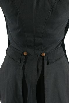 A rare gentleman's navy wool tailcoat, circa 1815. double-breasted with M-notched lapels, kite-shaped rear seaming, black silk covered buttons, sleeve is gathered at the shoulder, high collar, quilting to inside chest and lower neck areas, brown velvet added to line the cuffs, brown chintz lined pockets concealed within the tails,