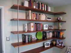 A handcrafted floating corner bookshelf by BDJ Craftworks in Austin, Texas.