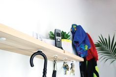 Shelf with magnets attached to it to store keys