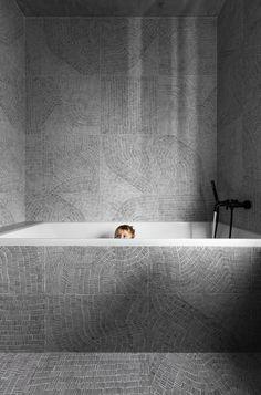 Designed for a family, architect Sergey Makhno created the Wabi Sabi Apartment by merging elements of Ukrainian design with Japanese minimalism. Wabi Sabi, Family Apartment, Apartment Design, Apartment Renovation, Best Bathtubs, Japanese Minimalism, Bathtub Tile, Concrete Bathroom, Asian Home Decor