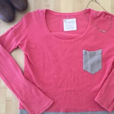 FREE PEOPLE This gorgeous two toned shirt is in perfect condition with no rips stains or tears. It's accented with a front pocket and a 4 inch seam slit on the sides. The fabric is Henley style. Make an offer Free People Tops Tees - Long Sleeve