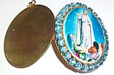 Large vintage (new old stock) Cameo Locket featuring The Blessed Mother Virgin Mary as Our Lady of Fatima, porcelain cameo cabochon center surrounded by Sky Blue crystal rhinestones.