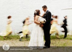 Fun wedding photography - wedding party running by.  Vancouver.