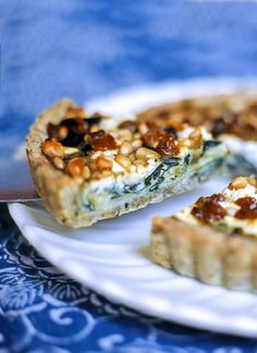 This elegant swiss chard, leek, and goat cheese tart, studded with raisins and pine nuts is a stunning vegetarian brunch or appetizer.