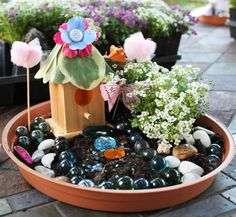 Fairy Garden Party Birthday Party Ideas | Catch My Party: Create mini fairy gardens with potting soil, flowers, bird houses, shells, glass beads, and plastic gems!