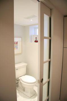 Fantastic Bathroom Boasts A Frosted Glass Water Closet Door Custom Bathroom Doors Design Inspiration