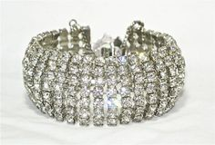 VINTAGE WIDE WEISS CLEAR RHINESTONE 7 ROW BRACELET DESIGNER SIGNED JEWELRY RARE    Seller information  justinsublime (1840  )    99.9%Positive feedback  Save this seller  See other items     AdChoice  Item condition:--  Time left: 22h 4m 7s (May 12, 2013 18:30:53 PDT)  Current bid:US $22.50  [12 bids ]