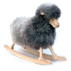 Fuzzy Wuzy - This is the coolest rocking horse (sheep?) ever.