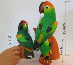The Family - Set of 3 Jungle Parrots - Hand Carved Balsa Wood Fine Artisanry - Handmade Carvings - Decoration Birds by JungleBirds. $38.99. These balsa wood carvings are made by hand with exotic colors and designs inspired in the flora and fauna of the Amazon rainforest.. This unique set was carved just for you in resemblance of the Saffron-headed Parrot species.. The Family is a set conformed by 3 handmade pieces which are 12, 8 and 4 inches tall each.. The F...