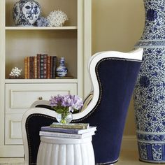 navy velvet with nailhead trim, white wood chair, so pretty