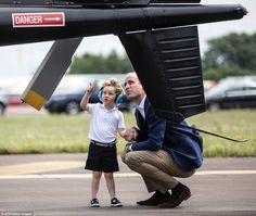 Who is giving who a lesson? According to Flight Lieutenant Jim Hobkirk who escorted the royals, Prince George 'was very interested in the tail rotor'