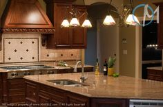 Juparana Golden Vyara Granite in Kitchen.  Gold walls, cream pink/peach and brown backsplash