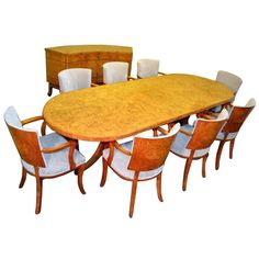 Antique Art Deco Dining Table plus 8 Chairs  Sideboard  | From a unique collection of antique and modern dining room sets at http://www.1stdibs.com/furniture/tables/dining-room-sets/