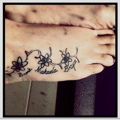 My Tattoo dedicated to my kids Brock, Makaela, Bryce. Flowers are symbolic of…