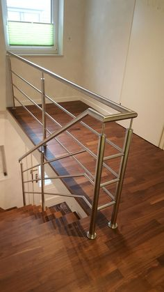 Elegant stainless steel railing made of round tube. Steel Railing Design, Staircase Railing Design, Interior Stair Railing, Metal Stair Railing, Staircase Handrail, Stainless Steel Stair Railing, Stainless Steel Handrail, Stainless Steel Doors, Balcony Grill Design