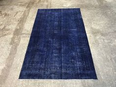 A personal favourite from my Etsy shop https://www.etsy.com/listing/531412555/dark-blue-turkish-overdyed-vintage-rug