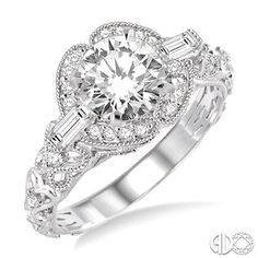 Take Your Vows To Give Her Unconditional Love For Life With This Exquisite Milgrain Finish Diamond Semi-mount Ring. Fashioned In 14 Karat White Gold This Ring Is Complemented By Dazzling Pave Set, Baguette, & Round Cut Diamonds Framing A Circle.This Ring Is Designed To Showcase Your Choice Of Center Stone Ranging From 0.90 Carat To 1.20 Carat. Total Diamond Weight Is 3/8 Ctw