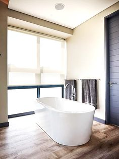 To accompany an already beautiful bathroom we added some rustic brown laminates to complete this soft, inviting look I think it is bath time